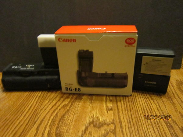 {SOLD}   Canon battery grip + battery + charger {$...
