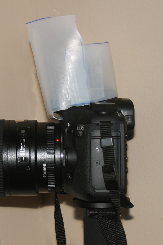 place diffuser over flash and hook the creased edg...