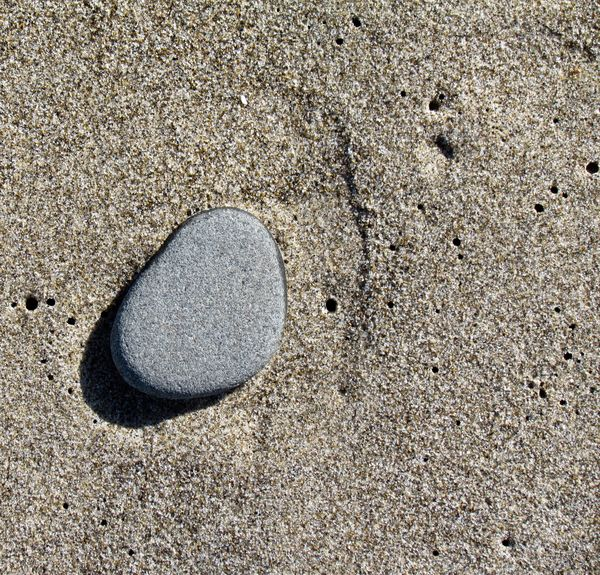 smooth stone on sand with worm holes.....