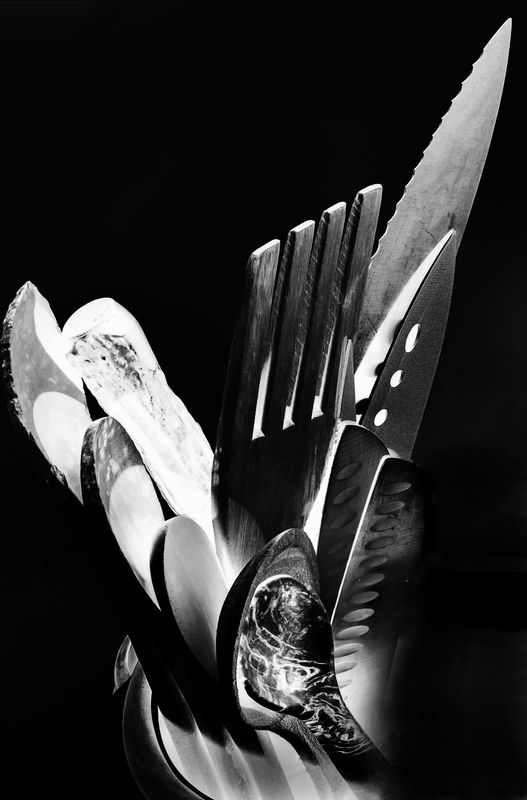 knives, fork and spoons inverted....