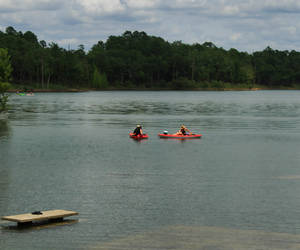 Kayaks on Broken Bow Lake there are some tables an...