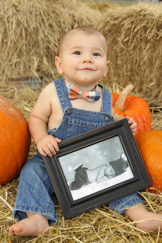 He's holding his newborn photo....