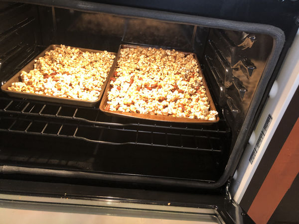 I popped some corn, added some almonds, and mixed ...