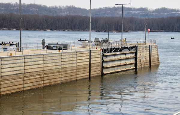 The gate is open in the lock and dam...