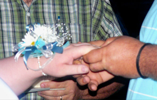Hands joining Hearts in Marriage...