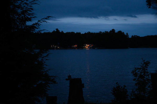 Nightfall, lights on, party heard around the lake...