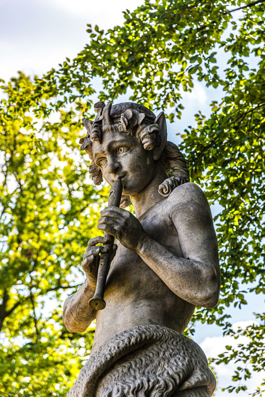 9 - Close-up of the statue of a girl playing a flu...