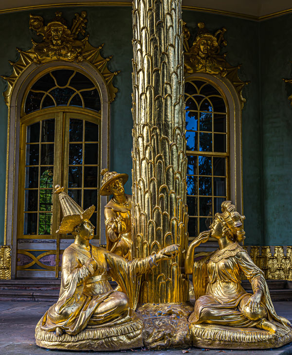 7 - Group of statues with a man presenting a gift ...