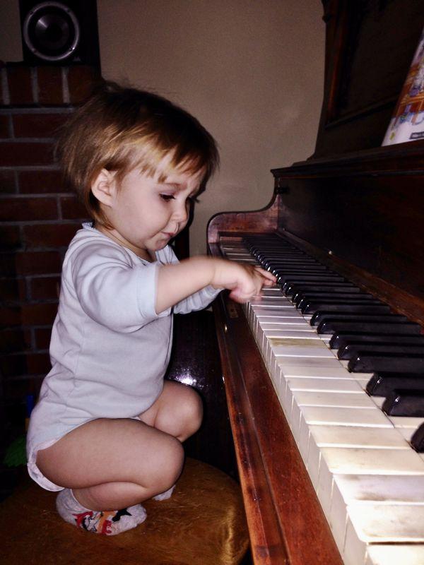 little Rachel( now 25) testing my antique piano......