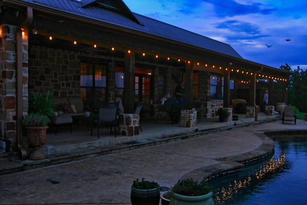 The Back Porch with Lights reflected in the Pool....