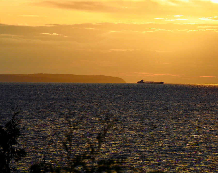 A northbound Great Lakes ship passing through the ...